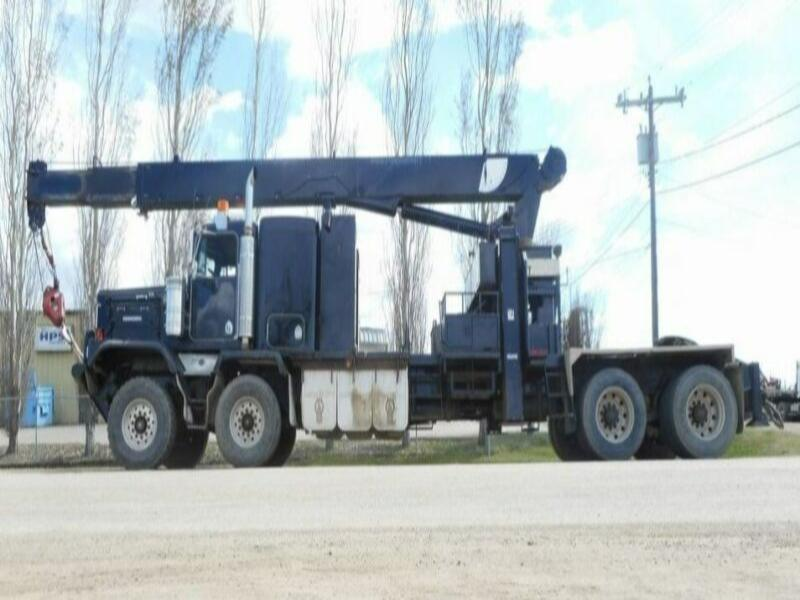 2002 KENWORTH C500B T/A T/A WITH 30 TON NATIONAL 1169 BOOM TRUCK