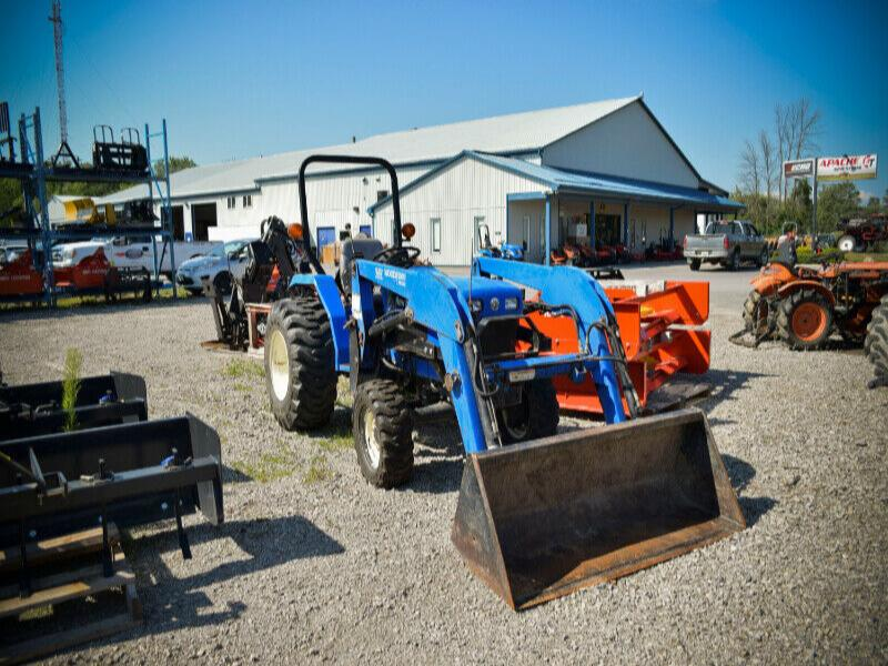 New Holland TC30 tractor with Woods 1009 loader