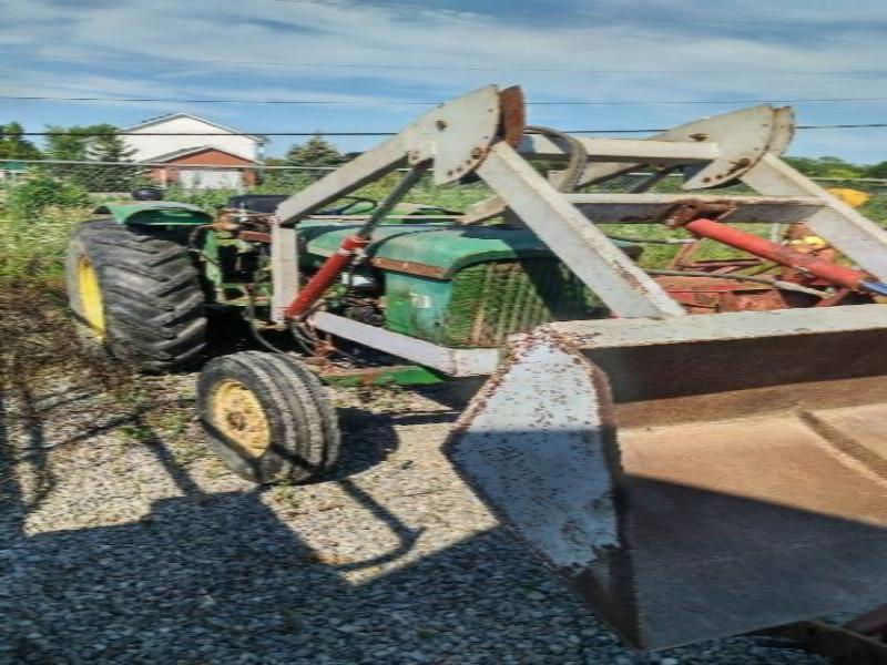 John Deere 710 tractor with loader