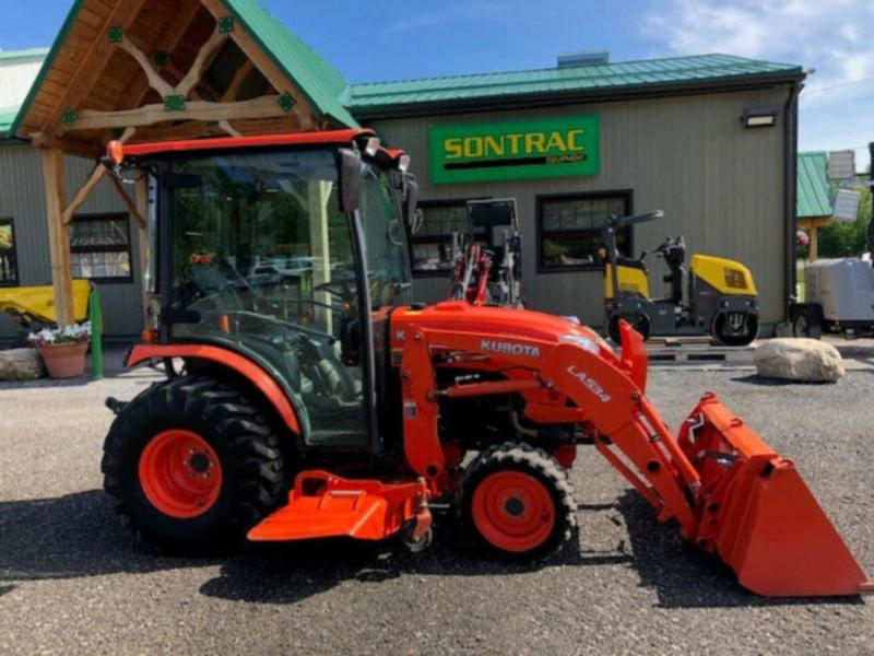 2015 KUBOTA B3350 – CAB TRACTOR WITH LOADER AND MOWER!