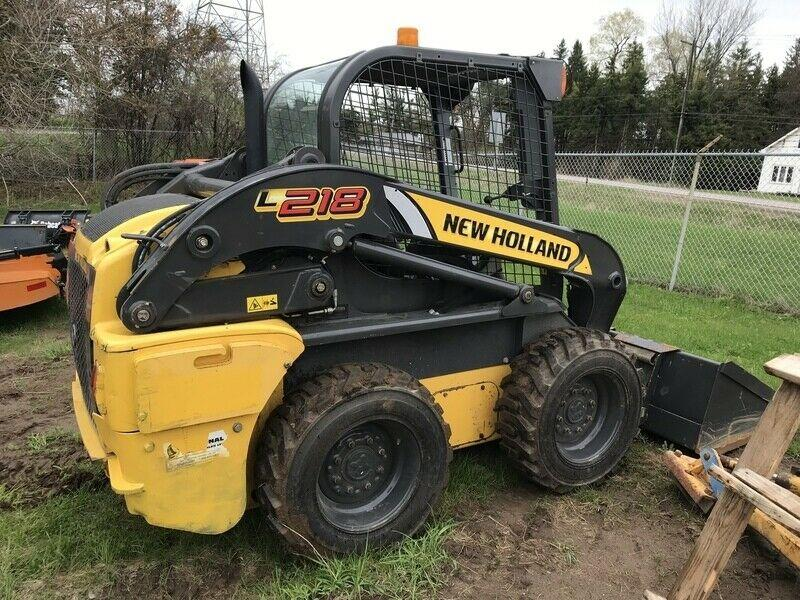 New Holland L218 skid steer- open station